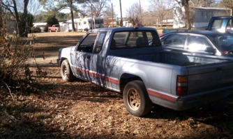 Tatted Mazdawgs 1987 Dodge D50 photo thumbnail