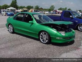 lowfires 1995 Pontiac Sunfire photo thumbnail