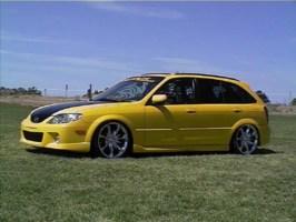 eazilyamuzeds 2002 Mazda Protege 5 Wagon photo thumbnail