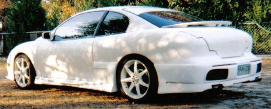 White Car ROBs 1995 Pontiac Sunfire photo